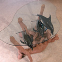 Glass-top table with 3 dolphins