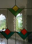 closeup of French Doors with stained glass